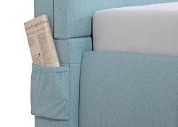 újságtartó az ágy oldalában