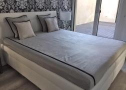Gala ágy fehér NTLO fehér textilbőrrel vásárlónk otthonában